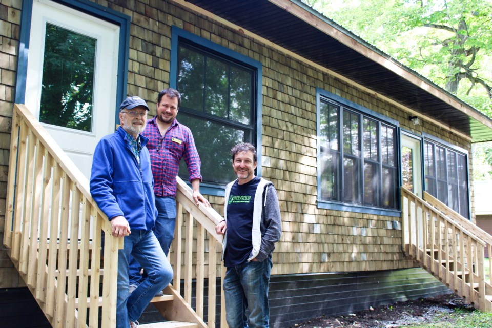 Gord Ball, left, of Sustainable Orillia, Brian Shelley, centre, vice-president of YMCA of Simcoe/Muskoka, and Chris Magwood, of the Endeavour Sustainable Building School, are shown outside a new cottage that was built at YMCA Geneva Park in Ramara Township. Nathan Taylor/OrilliaMatters