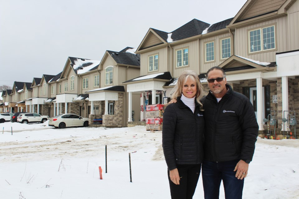 Bernadette Wainman and Dennis Bottero, of Landen Homes, are shown in front of Churchlea Mews, their townhouse development on James Street. Nathan Taylor/OrilliaMatters