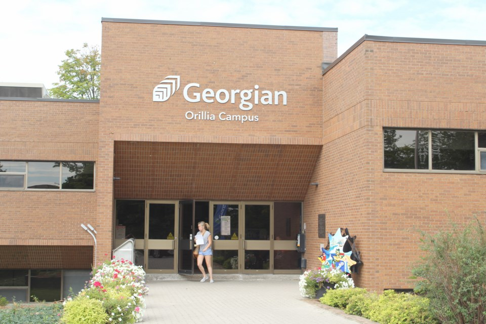 A student exits Georgian College's Orillia campus. Nathan Taylor/OrilliaMatters File Photo