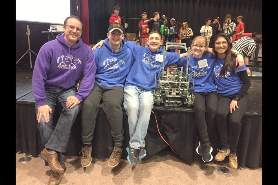 A senior team from the Patrick Fogarty Robotics Academy has qualified for the world championship, which will take place in April in Louisville, Ky. The team includes, from left, coach Mike Milliard, Logan Woodrow, Andy Lentini, Jessica Cuthbertson and Julianne Pires. Supplied photo