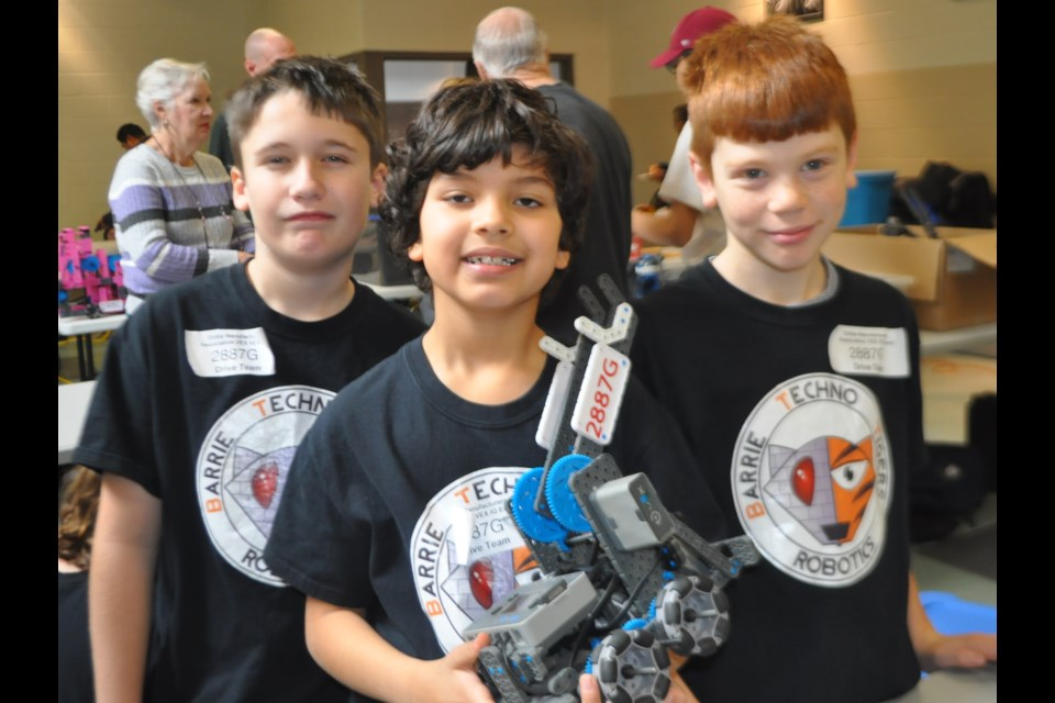 Barrie Techno Tigers Robotics team members Elijah O'Neil, 12, Max Sopuch, 8 and Alex Galarneau, 9, work on their robot during Saturday's event. Andrew Philips/OrilliaMatters