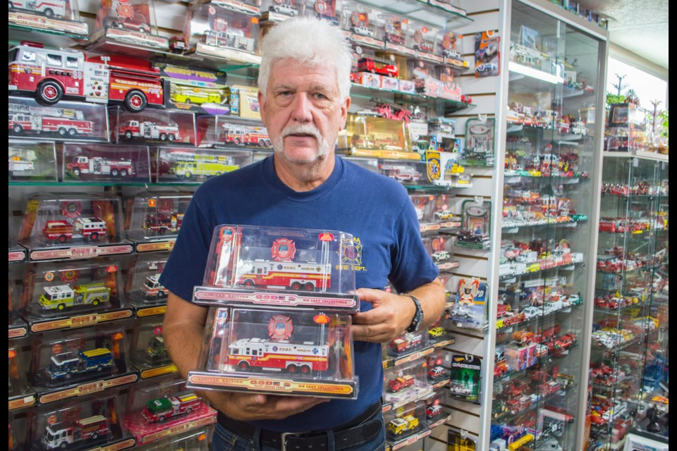 Local firefighter Barry Denne honours and remembers firefighters who lost their lives on 9/11 through his own collection of more than 2,000 model fire trucks. Tyler Evans/OrilliaMatters