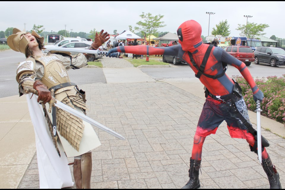 Did the Kingsguard really have a chance? Daniel Ford, left, representing the Game of Thrones character, found himself on the losing end of an impromptu sword fight with Deadpool (Gavin Fockens) Saturday during Cottage CountryCon at Rotary Place. Nathan Taylor/OrilliaMatters