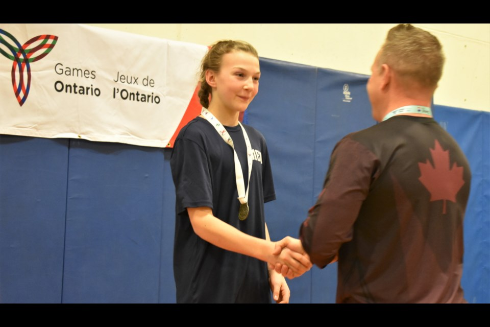 Lauren Smith is presented her gold medal after she went undefeated in her bouts at this weekend's Ontario Winter Games wrestling competition. The medal ceremony was held Saturday after the two-day competition wrapped up. Dave Dawson/OrilliaMatters