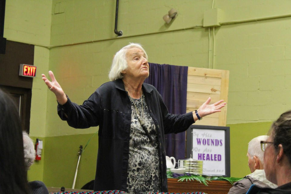 A frustrated Dorothy Cook addresses the audience Wednesday at the Orillia Community Church during a town hall meeting regarding changes to the Ontario Autism Program. Nathan Taylor/OrilliaMatters