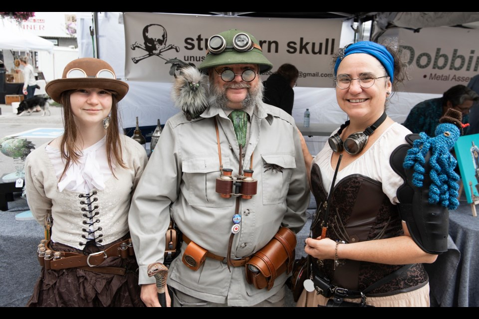 Many people put lots of efforts into costumes to embrace the vibe of the Coldwater Steampunk Festival Saturday. From left: Kathleen Brosseau, Dominique Dutour and Gaia Dutour stop to pose in downtown Coldwater Saturday. Will Acri/OrilliaMatters