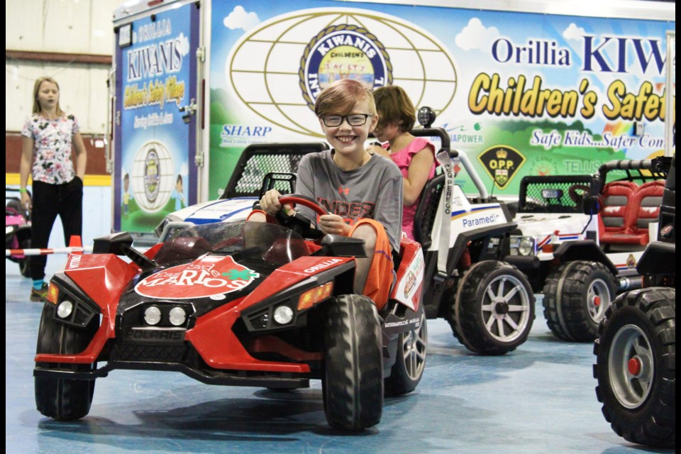 Kids enjoyed riding around in mini-cars Wednesday at ODAS Park during a celebration to mark 10 years of the Kiwanis Children's Safety Village. Nathan Taylor/OrilliaMatters