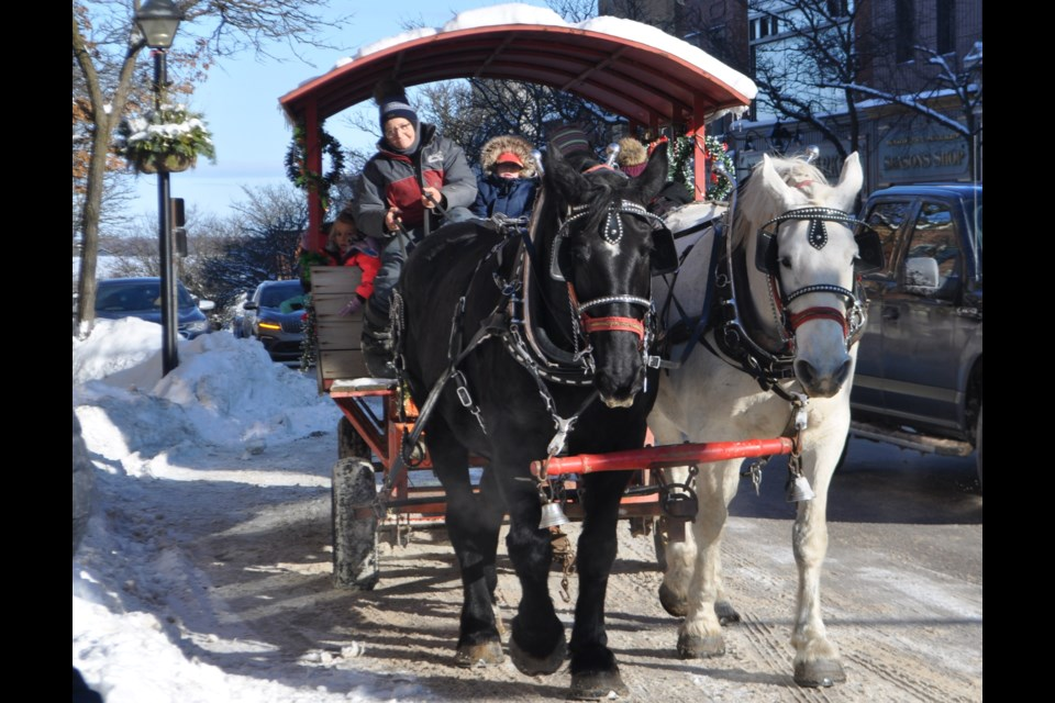 This horse-drawn sleigh ride proved to be a popular draw with area residents visiting downtown Orillia Saturday afternoon. Andrew Philips/OrilliaMatters
