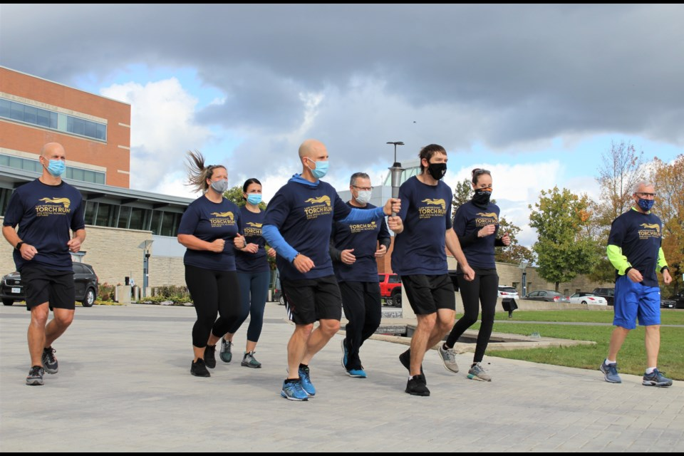 The kickoff to this year's virtual run included a short jog in front of OPP General Headquarters. Nathan Taylor/OrilliaMatters File Photo