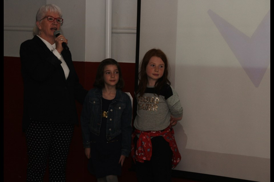 Mary O'Farrell-Bowers helps nine-year-olds Alida Tomasini and Ava Shami take questions from the judges. The two won $150 from the judges. Mehreen Shahid/OrilliaMatters