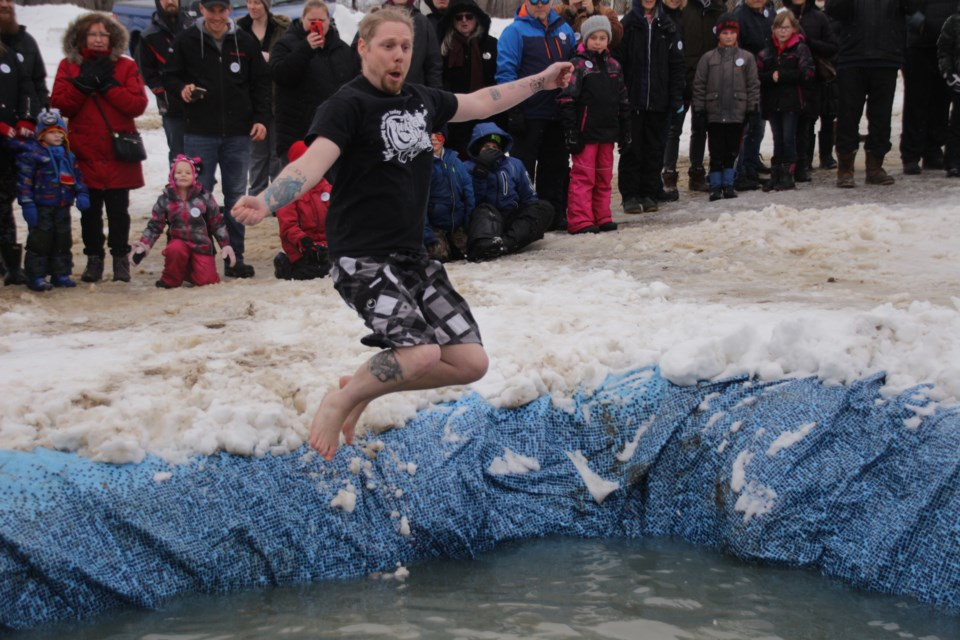 Chris Bronson, youth worker at the Orillia Youth Centre, jumped, with style, into the frigid Polar Bear Dip event at Severn's Winterfest Sunday. Mehreen Shahid/OrilliaMatters