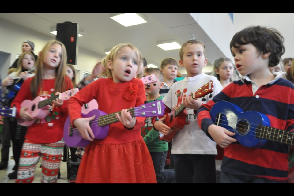 The Hummin' and Strummin' Ukulele kids played holiday favourites Saturday afternoon at Thor Motors. Andrew Philips/OrilliaMatters