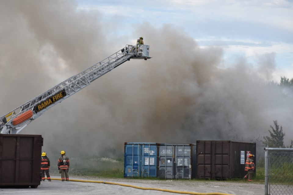The Rama Fire Department's aerial truck was deployed to help fight the garbage fire from above Friday evening. Dave Dawson/OrilliaMatters