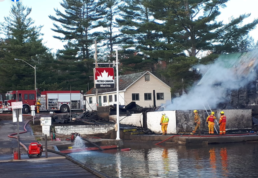 Severn Township firefighters battle a blaze at the old Stanton Brothers Store, a Port Stanton landmark for more than 100 years. The building was destroyed. Gord Launchbury photo