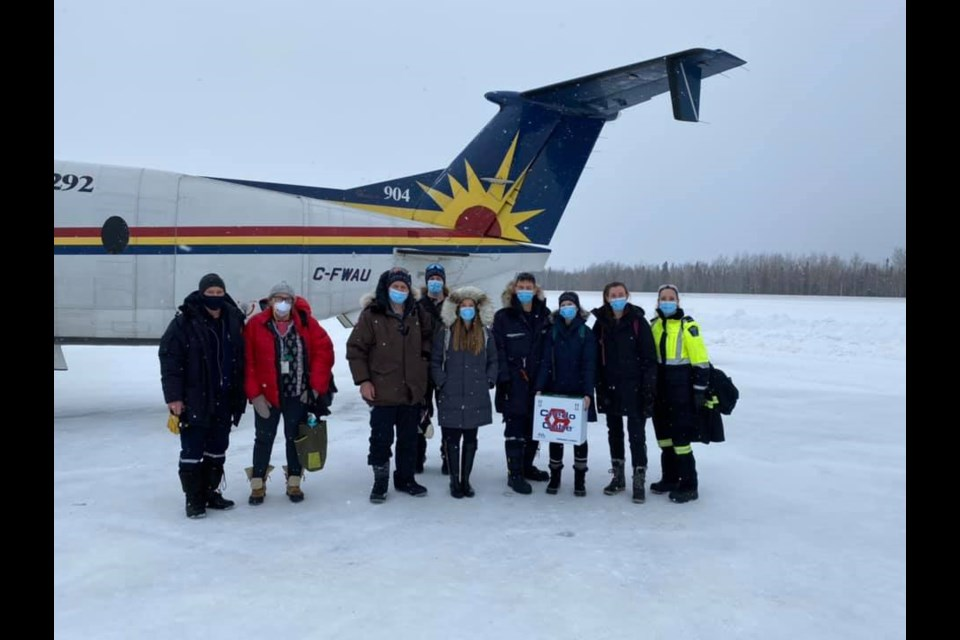 Jonathan Lee (fourth from the right), a Georgian College instructor and Ornge paramedic, and an Ornge vaccination team in Eabamatoong First Nation. Lee will return to the community on March 22 with a team of six from Georgian to administer COVID-19 vaccines. (Photo courtesy of Jonathan Lee)