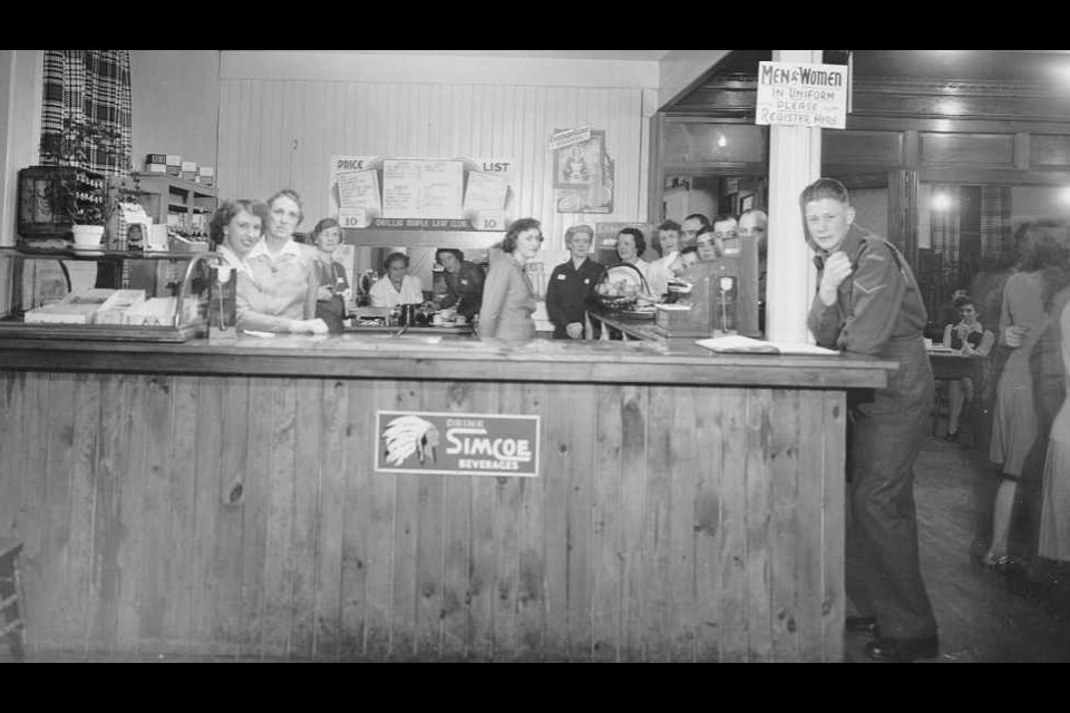 The canteen sold coffee, tea, milk, soft drinks and sandwiches. A sign promoting Simcoe Dry, a local soft drink, can be seen on the front of the counter.