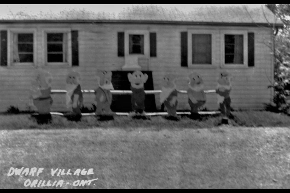 Dwarf Village, on Victoria Crescent, on the shore of Lake Simcoe  was a popular summer destination for more than 40 years. This postcard shows the plywood cutouts of the Seven Dwarfs.