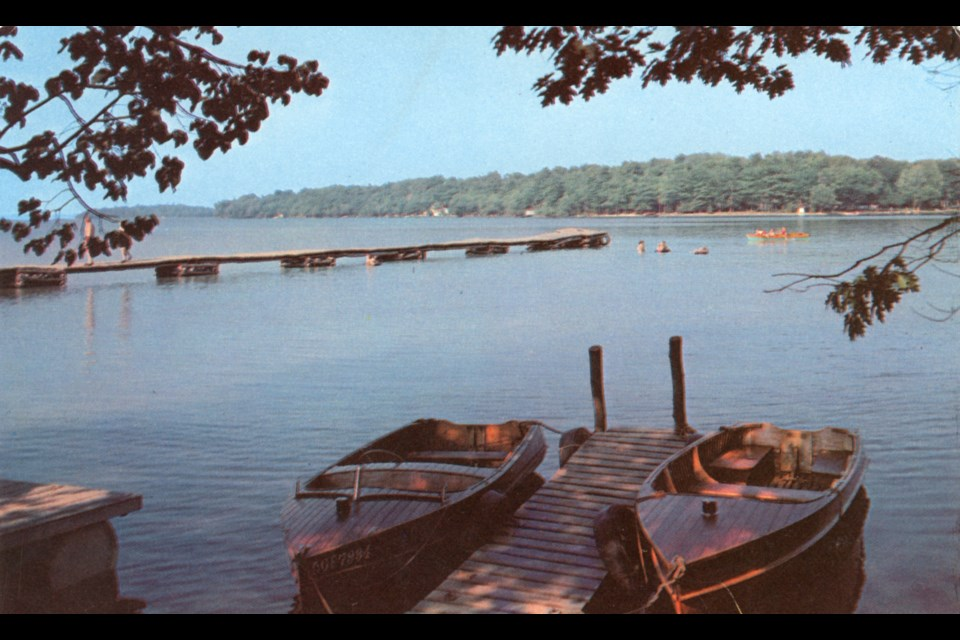 This postcard shows the idyllic view from the dock at the Orillia Motor Camp, circa 1950.
