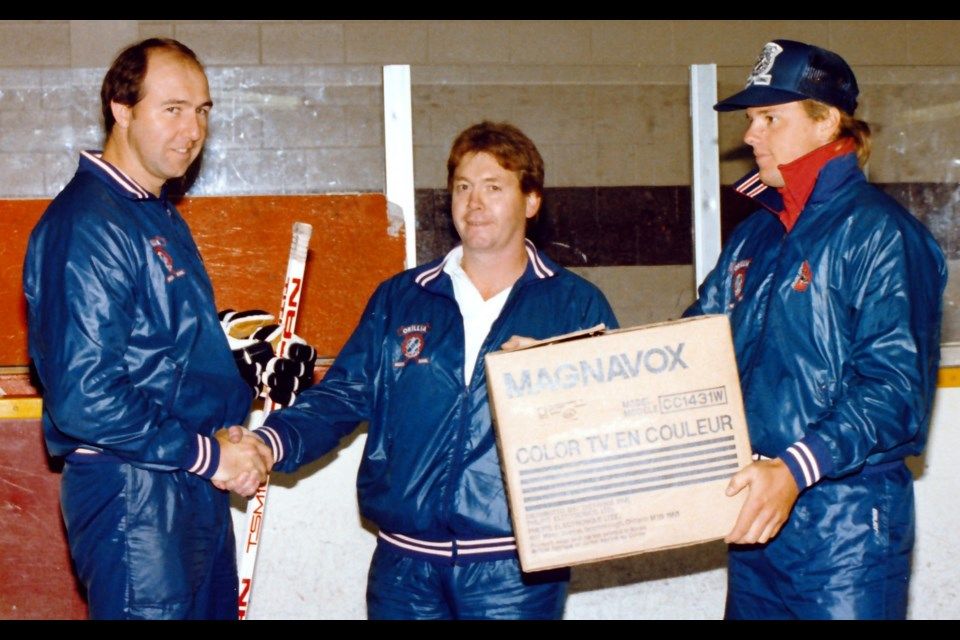 Terriers president Don Stoutt is flanked by Toronto Maple Leafs player Jack Valiquette, left, and star Orillia winger Stu Burnie at the Kinsmen Hockey School, which was held each summer at the Brian Orser Arena. Tonight, Burnie and Stoutt will be inducted into Orillia's Sports Hall of Fame.