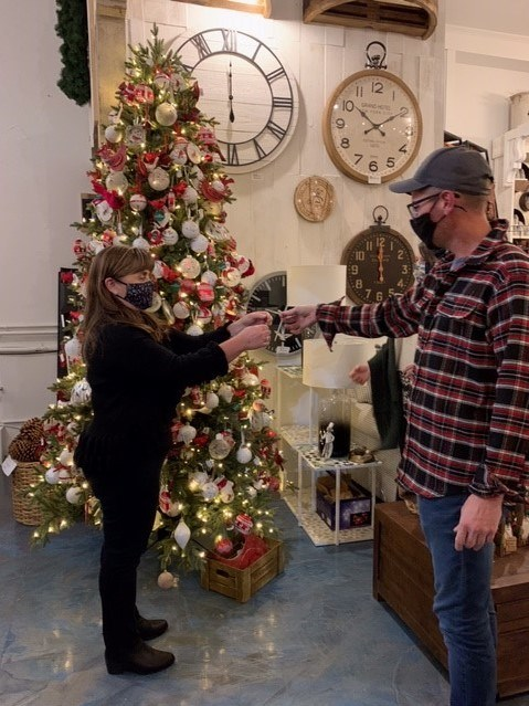 Heather Breckles and Cristopher Orchard-Campbell decorate the Angel Tree, which honours loved ones and supports Mariposa House Hospice Contributed photo