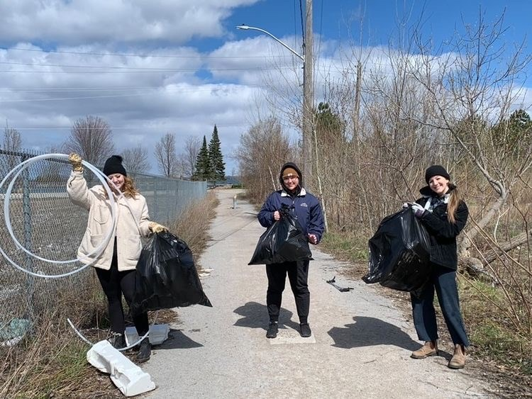 Maddy Forrnier, far right, and friends gathered to pick up garbage for the Green Orillia Earth Day 2021 garbage pickup.