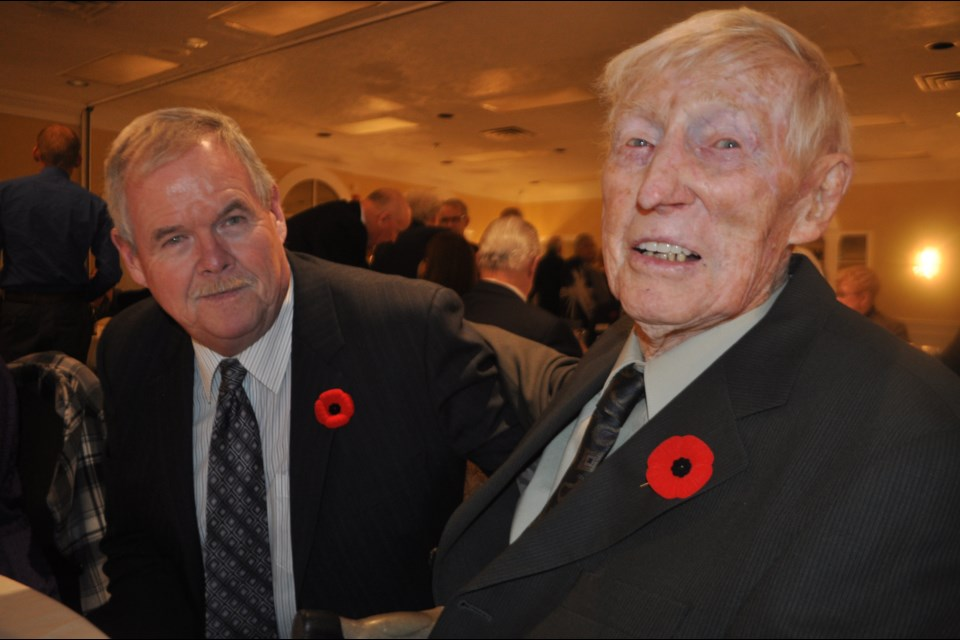 Fred Coulson, right, pictured with good friend Glen Adams, said events like the annual veterans' dinner play an important role in bringing people with similar experiences together. Andrew Philips/OrilliaMatters