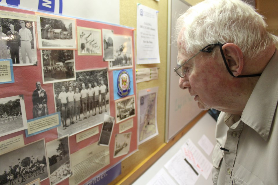 Alex Saunders checks out photos from his time at the Ontario Educational Leadership Centre in Longford Mills in 1948. Nathan Taylor/OrilliaMatters