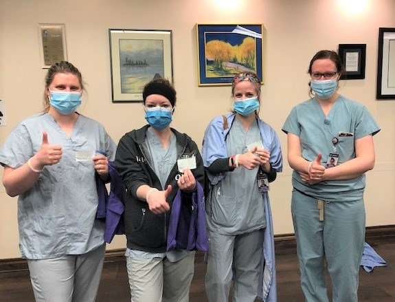 Health-care workers at Orillia Soldiers' Memorial Hospital give thumbs up while wearing bracelets given to them by the young members of the local YMCA's Community Action Network. OSMH Foundation/Supplied photo