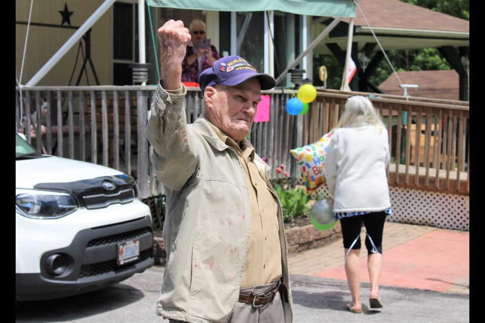 Harold Rowden watches as friends parade past his Ramara home Sunday to wish him a happy 96th birthday. Nathan Taylor/OrilliaMatters