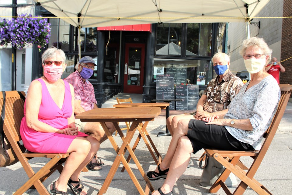 From left: Nancy Menagh, Roy Menagh, Fred Larsen and Lois Larsen got together at Tre Sorelle on Friday for the first of the city's See You on the Patio events. Nathan Taylor/OrilliaMatters