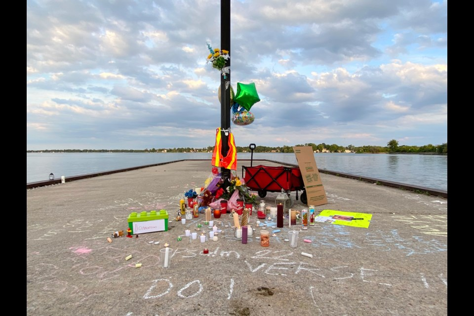 A memorial for Chris Bellchambers at the government dock is shown in this file photo.