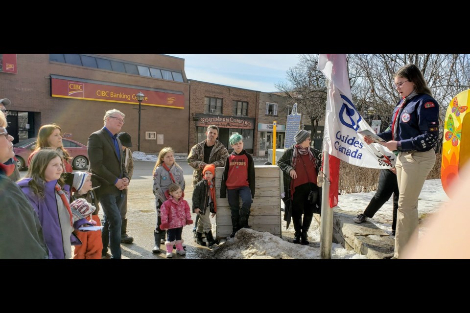 Orillia Mayor Steve Clarke looks on as a youth speaks about the value of Scouting as the city marked Scout Week with a flag-raising in front of the Orillia Opera House. Photo supplied by Scouts Canada.