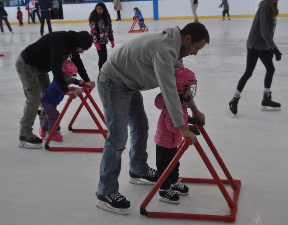 2019-02-16 fam day dads skating with girls