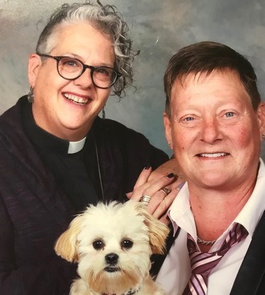 Rev. Lori Pilatzke, left, pastor at St. David Anglican-Lutheran Church in Orillia, is shown with her wife, Jen Macklin, and their dog, Luna. Supplied photo