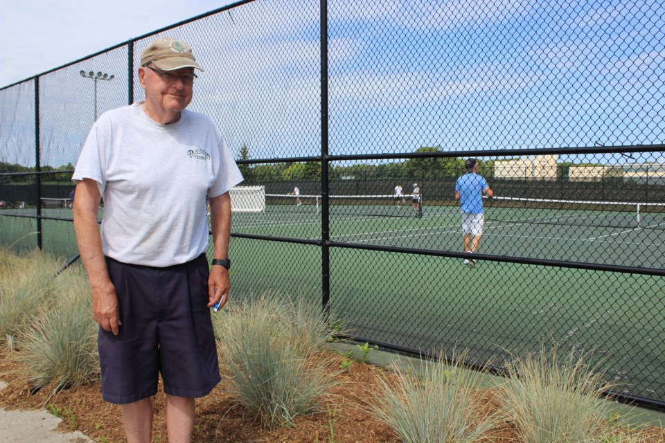 Tom Griffiths is shown next to the garden that borders the tennis courts at the West Orillia Sports Complex. He is upset that the city removed the milkweed from the garden, as it served as a habitat for monarch butterfly pupae. Nathan Taylor/OrilliaMatters