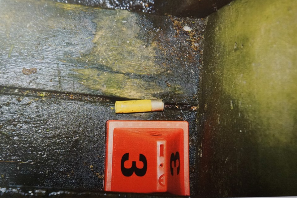 Police evidence photo of a shotgun shell casing found at 282 Franklin St., presented during the first-degree murder trials of Martin Forget and Brian Quesnel.