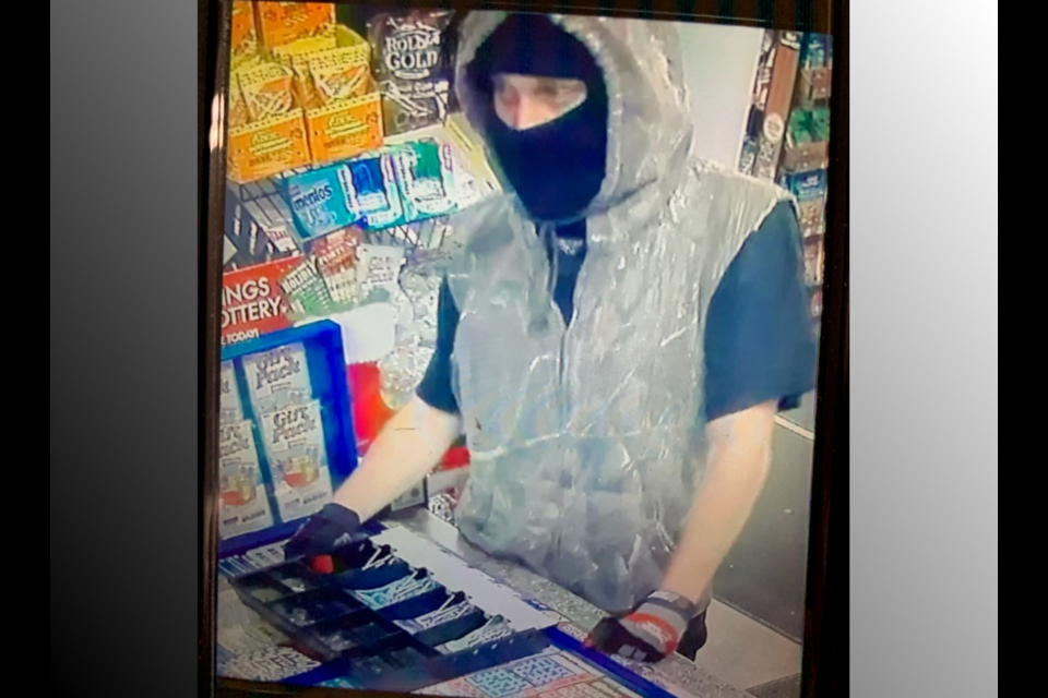 Police provided photo shows robbery suspect.
