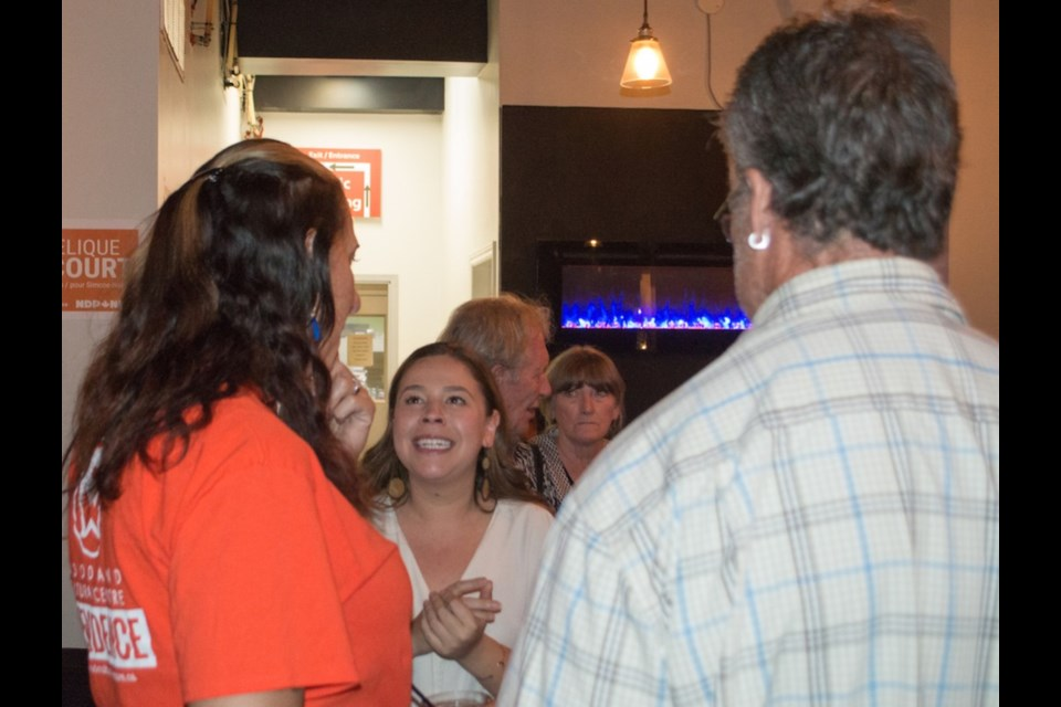 Simcoe North NDP candidate Angelique Belcourt is congratulated by her supporters in Midland Monday night. The 23-year-old, who helped her party make significant gains compared to the previous federal election, said she would consider running again. Tyler Evans/OrilliaMatters