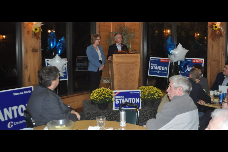 MP Bruce Stanton, with his wife, Heather, addresses supporters gathered at Bonaire Golf Club in Coldwater Monday night. Stanton topped the polls for the fifth straight time in Simcoe North. Andrew Philips/OrilliaMatters