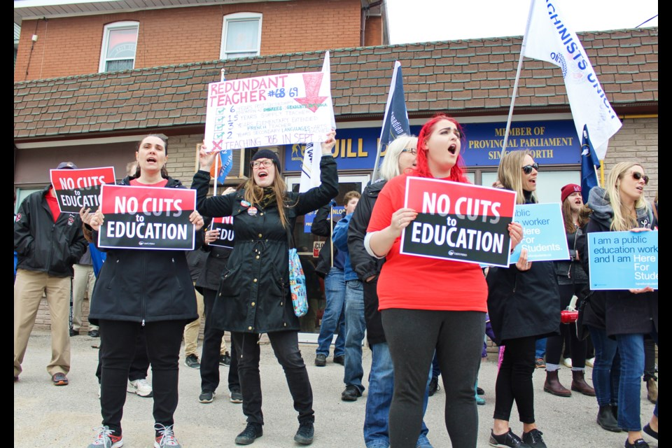 Demonstrators chant in front of Simcoe North MPP Jill Dunlop's Orillia office Friday. Nathan Taylor/OrilliaMatters