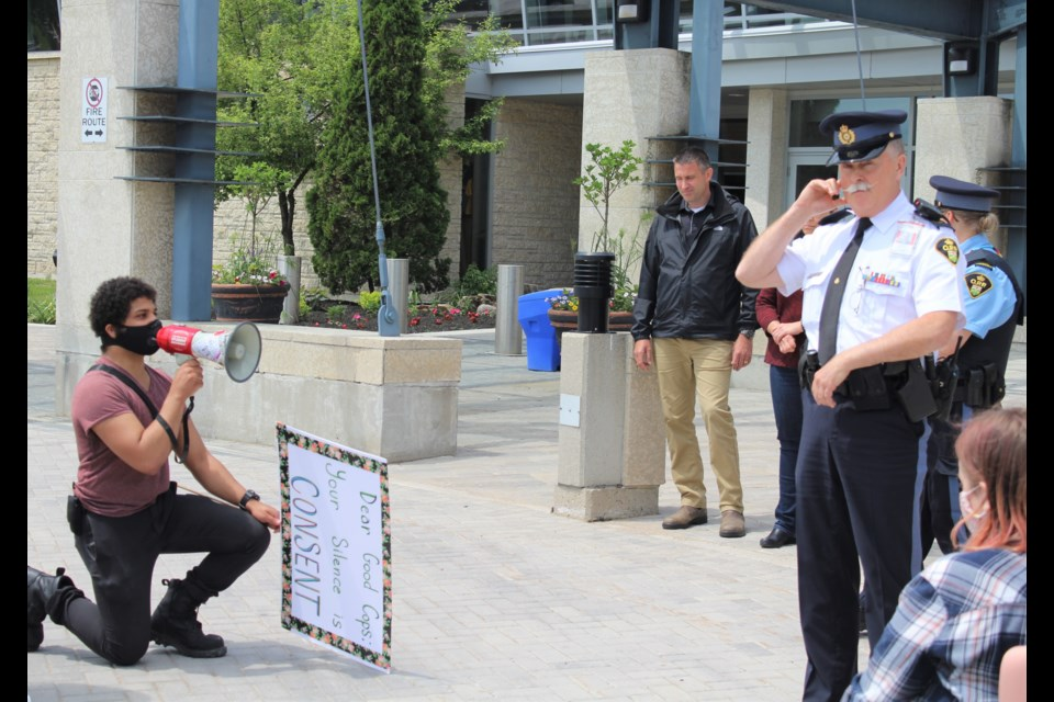 Daniel Tucker asks police to kneel with him during a demonstration Wednesday at OPP General Headquarters in Orillia. Nathan Taylor/OrilliaMatters