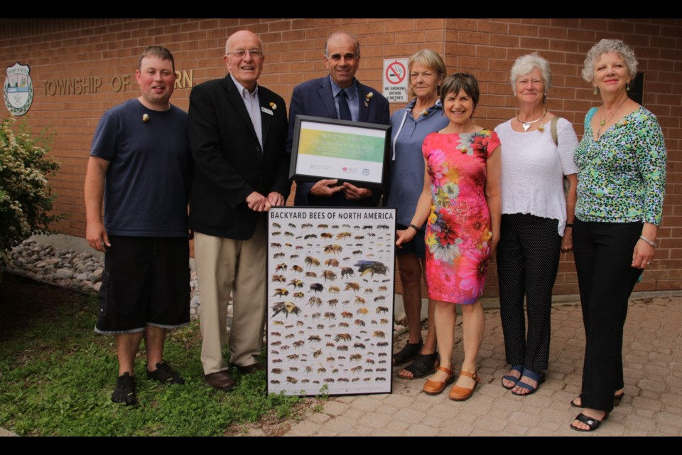The recently formed Orillia Bee City group designated Severn Township as a bee city today. From left are Matt Thomson, steward of Orillia Bee City, John Betwsorth, councillor ward 3, Mike Burkett, mayor, Judith Cox, councillor ward 2, Shelly Candel, founder Bee City Canada, Nancee Adams and Jeannine Hutty, stewards of Orillia Bee City. Mehreen Shahid/OrilliaMatters