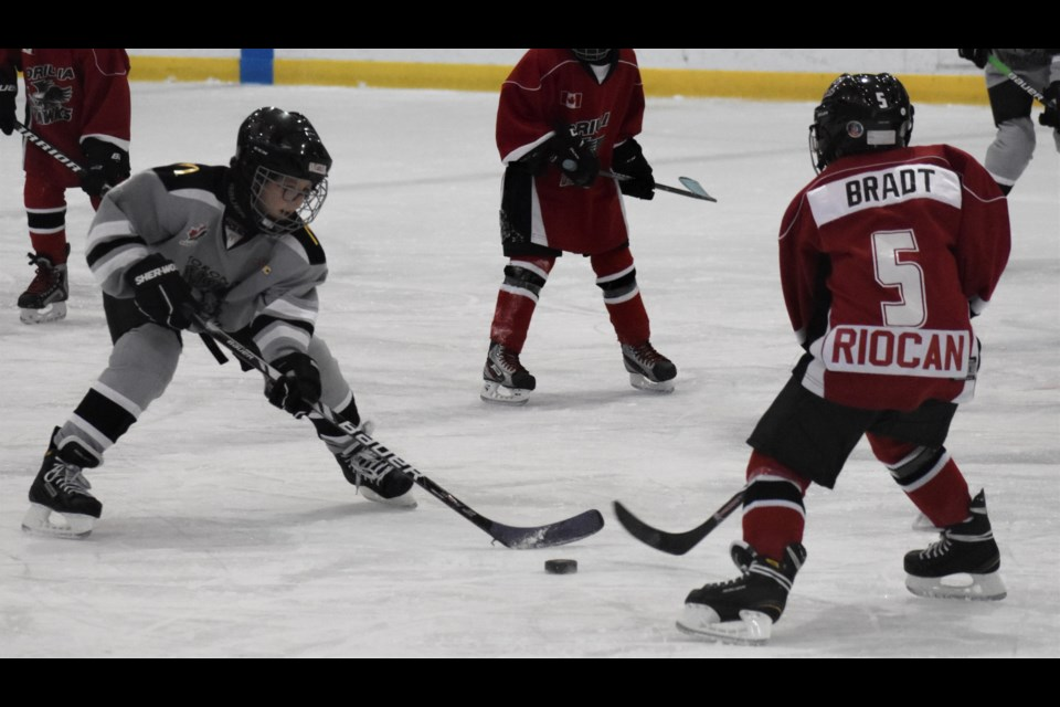 A Leaside forward carries the puck into the Orillia Hawks end during heated second-period action in a well-played game in the atom house league division. Orillia scored two third period goals, including an empty-netter, to earn a 4-0 win Saturday morning. Dave Dawson/OrilliaMatters