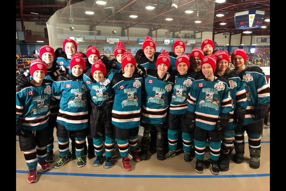 The Orillia Terriers atom squad was all smiles after winning the Heroes of Hockey Day competition. The team earned an all-expenses paid trip to Corner Brook, Newfoundland where they will participate in today's Hockey Day in Canada festivities.