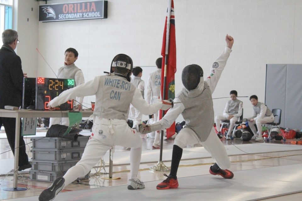 Nolan White-Roy, left, takes on an opponent Friday during Ontario Winter Games fencing action at Orillia Secondary School. Nathan Taylor/OrilliaMatters