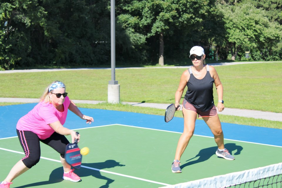 Vicki Reed, left, and Rhonda Adkins were at Friday's grand opening of the pickleball courts at Homewood Park to demonstrate how the game is played. Nathan Taylor/OrilliaMatters