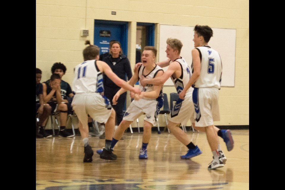 Aaron MacDonald celebrates with his teammates after nailing a buzzer-beating three point shot, en route to a 47-46 upset victory over G.L Roberts. It was the opening game of the 74th Orillia Blackball Classic for both teams. Tyler Evans/OrilliaMatters