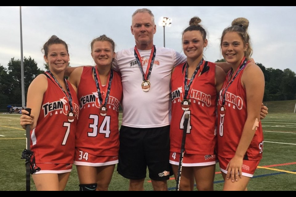 Several Orillia players and coaches helped power Team Ontario to its fourth straight national title. The Orillians are shown above, from left: Kennedy Lynch, Kassidy Morris, Pat Morris (coach), co-captain Hannah Morris and Paige Stachura. Contributed photo