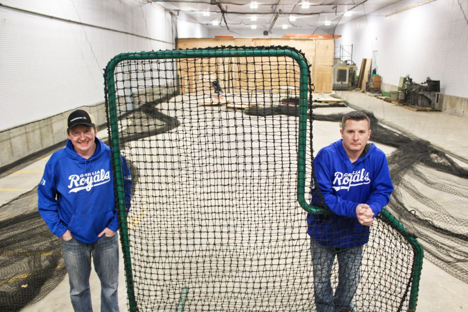 Wes Winkel, left, president of Orillia Legion Minor Baseball, and volunteer Terry Errico are shown at the league's new indoor training facility on Jamieson Drive in Oro-Medonte. Nathan Taylor/OrilliaMatters