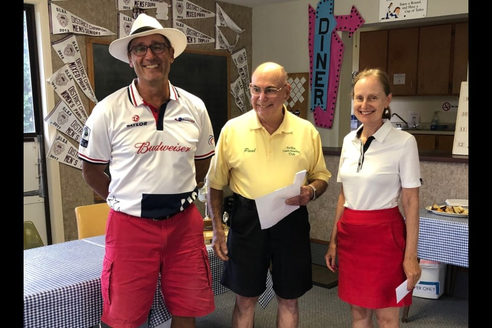 Orillia's Robb Barsevich and Laurie McLeod won three games at Thursday's Australian Pairs Tournament at the Orillia Lawn Bowling Club. They are shown with drawmaster Paul Evans.